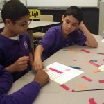 Three students work together to solve the recipe for the color Pink