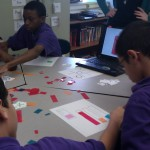 Students work together to solve the color mixing worksheets