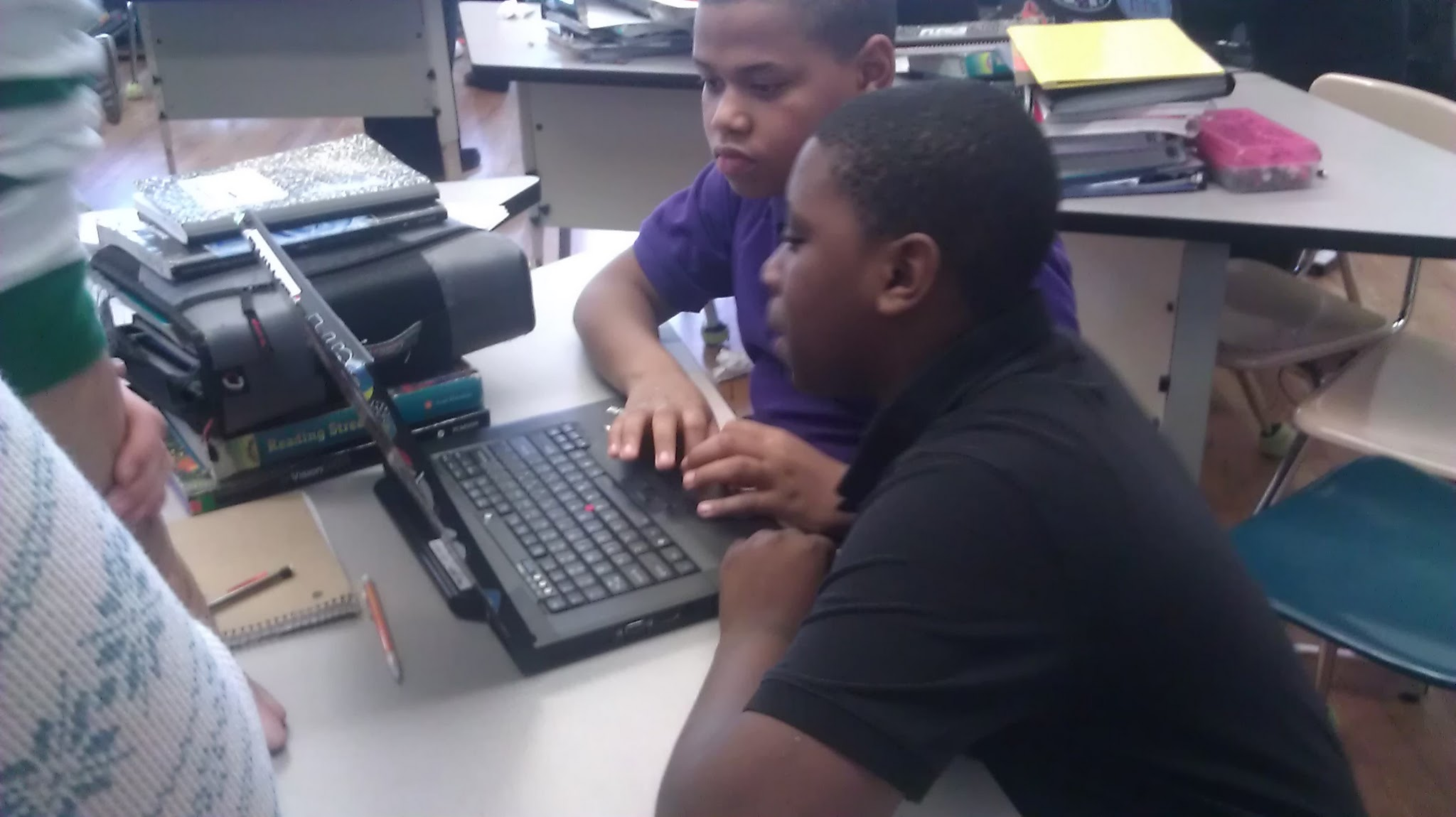 Two Boys Working Together