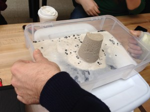 Testing using a building made from sand